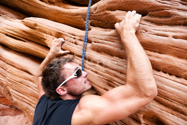 Climber man climbing on rock Stock photo © Maridav