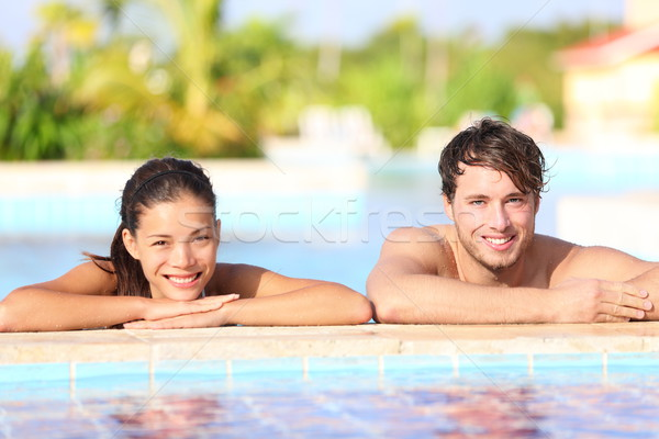 Young couple in pool Stock photo © Maridav