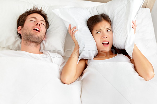 Snoring man - couple in bed Stock photo © Maridav