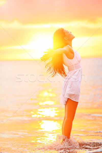 Free woman enjoying freedom feeling happy at beach Stock photo © Maridav