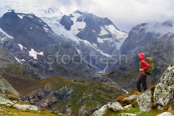 Hiking - hiker woman on trek with backpack in rain Stock photo © Maridav