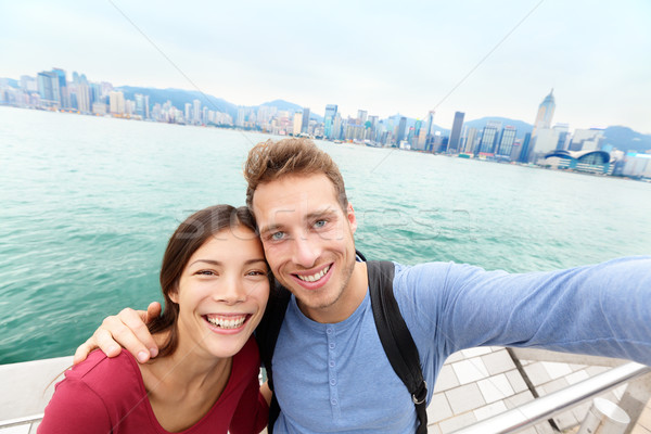 Selfie - Tourists couple taking picture Hong Kong Stock photo © Maridav