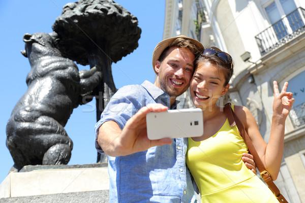 Tourists taking selfie photo by bear statue Madrid Stock photo © Maridav