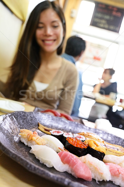 Sushi eating woman tourist in Tokyo restaurant Stock photo © Maridav