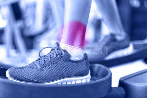 Hurting ankles - pain caused by fitness injury Stock photo © Maridav