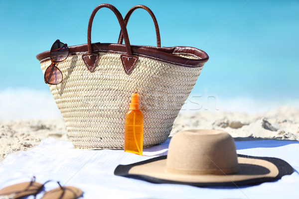 Beach bag and hat, sunglasses and sunscreen lotion Stock photo © Maridav