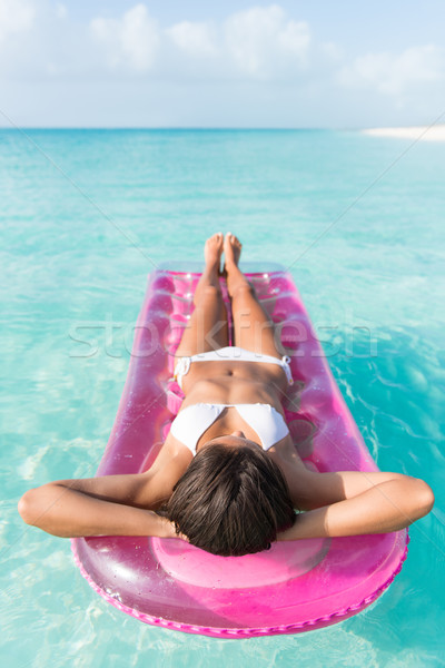 Beach vacation girl relaxing on ocean float bed Stock photo © Maridav
