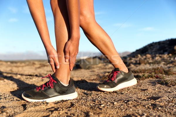Sprained ankle running injury athlete runner woman Stock photo © Maridav