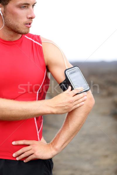 Running training music - runner man listening Stock photo © Maridav