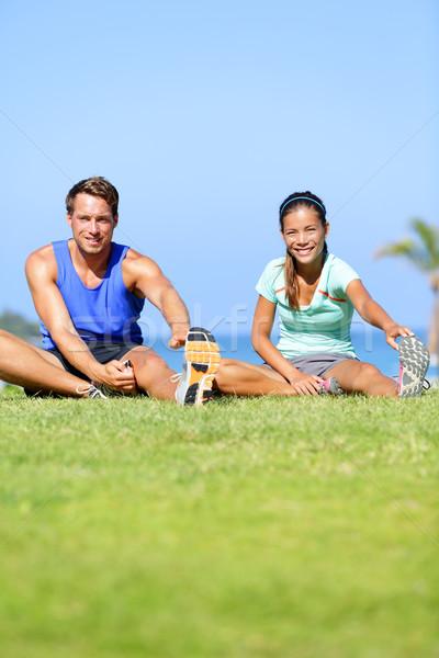 Fitness people - couple stretching exercises Stock photo © Maridav