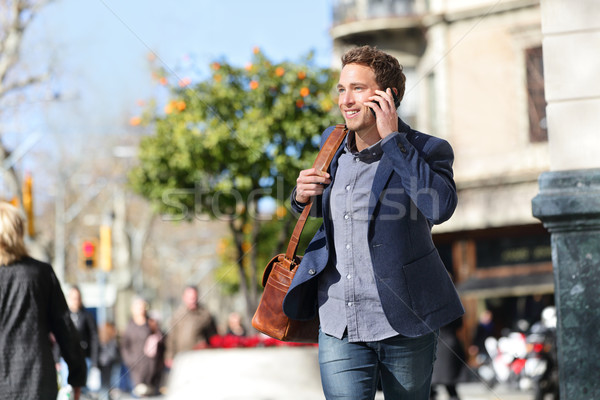 Young urban businessman on smart phone, Barcelona Stock photo © Maridav