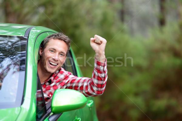 Groene energie elektrische auto bestuurder gelukkig opgewonden Stockfoto © Maridav