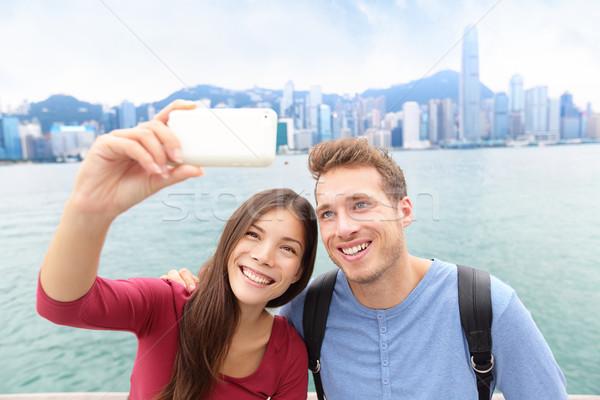 Selfie - friends taking picture in Hong Kong Stock photo © Maridav