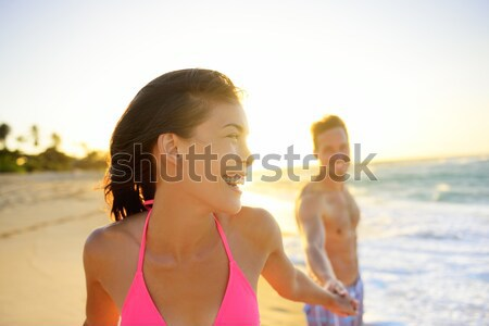 Stock photo: Romantic smiling young couple at beach in sunset