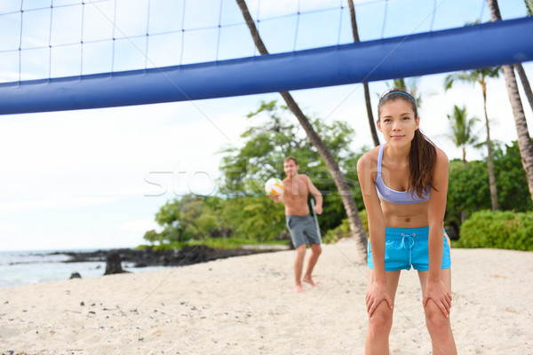 Beach volleyball serve - man serving in game Stock photo © Maridav