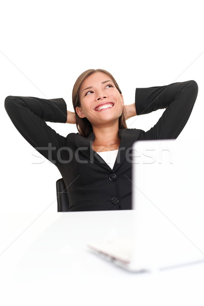 Cheerful business woman looking up Stock photo © Maridav