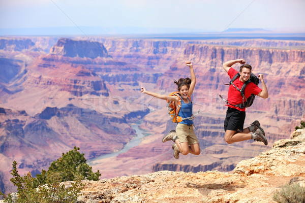 Happy people jumping in Grand Canyon Stock photo © Maridav