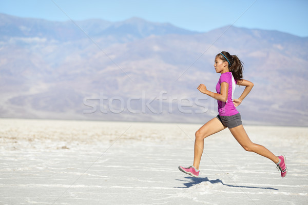 Running woman - runner sprinting on trail run Stock photo © Maridav