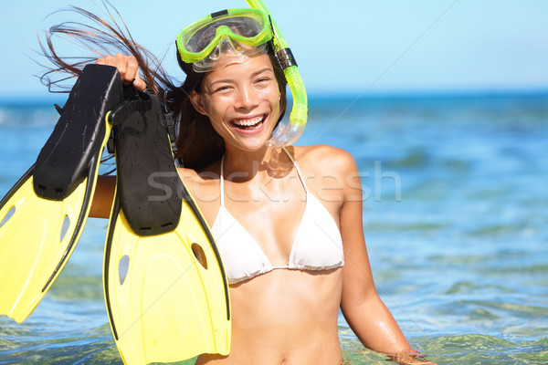 snorkeling fun on beach - woman showing fins Stock photo © Maridav