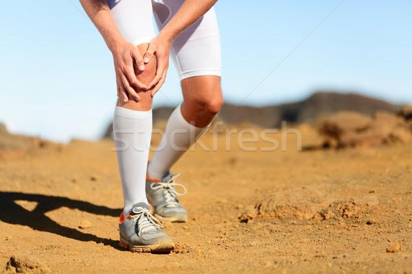 Running injury - Male runner with knee pain Stock photo © Maridav