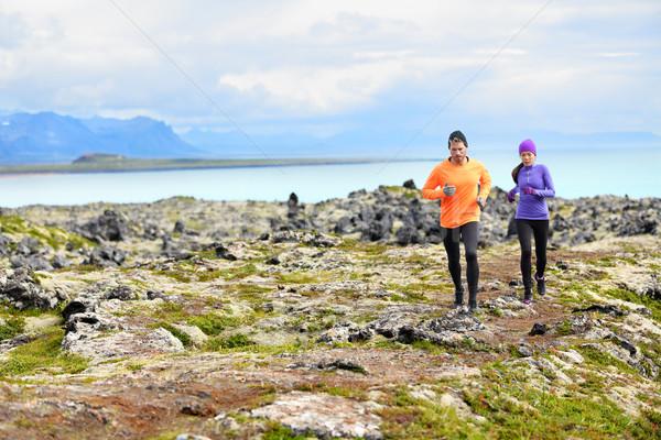 Exercise running sport - runners on cross country Stock photo © Maridav