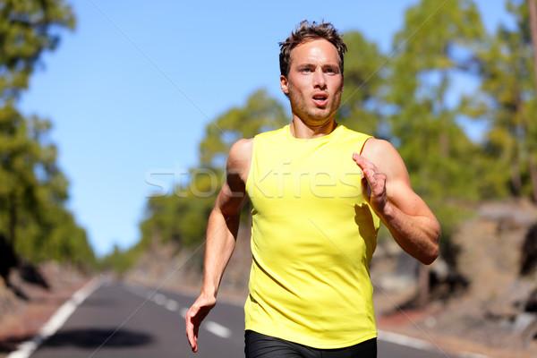 Running man sprinting for success on run Stock photo © Maridav