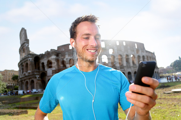 Boldog kocogó hallgat zene Colosseum férfi Stock fotó © Maridav