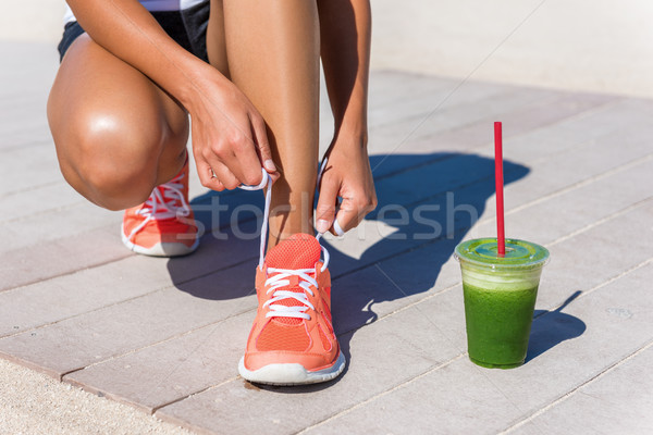Stock photo: Running woman runner with green vegetable smoothie