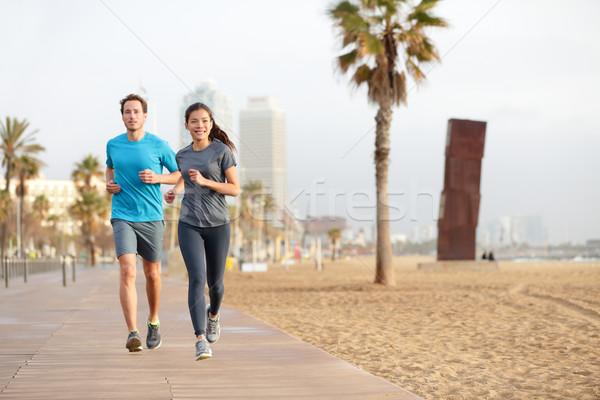 Fut pár jogging Barcelona tengerpart egészséges életmód Stock fotó © Maridav
