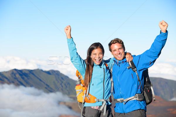 Hikers - people hiking cheering on summit top Stock photo © Maridav