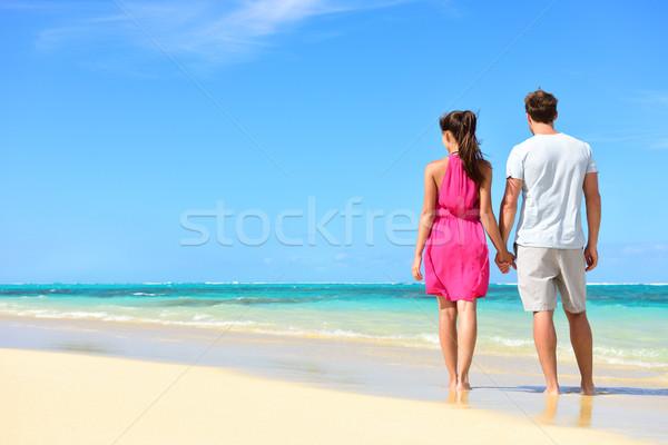 Summer holiday - couple on tropical beach vacation Stock photo © Maridav