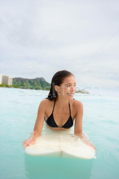Surfing surfer girl looking for surf on surfboard  Stock photo © Maridav