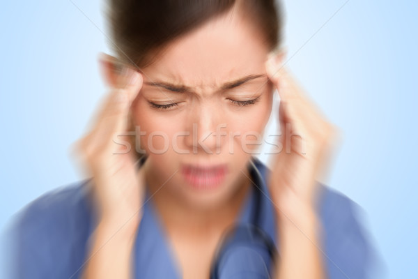 Stock photo: Nurse / doctor headache stress