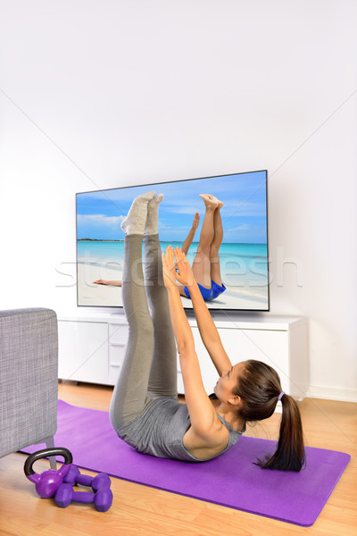 Home fitness ab workout in front of television Stock photo © Maridav