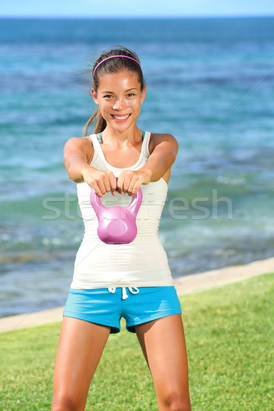 Kettlebell crossfit fitness woman Stock photo © Maridav