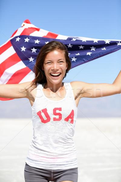 Athlète femme drapeau américain USA tshirt courir Photo stock © Maridav