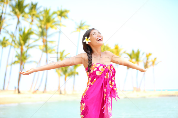 Happy woman praising freedom, palm beach in sarong Stock photo © Maridav