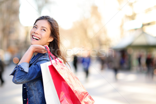 Shopping woman happy and looking away Stock photo © Maridav