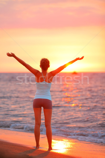 Stock photo: Happy freedom woman relaxing at beach sunset