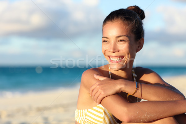 Happy healthy Asian chinese woman smiling on beach Stock photo © Maridav
