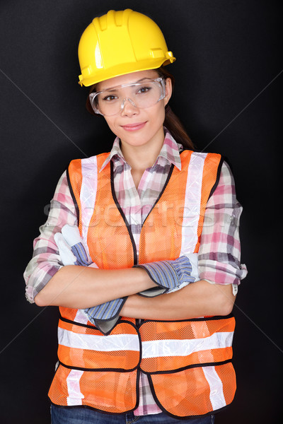 Construction worker with safety gear on black Stock photo © Maridav