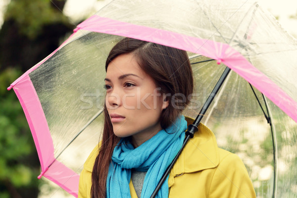 Melancholia - Melancholic woman in rain Stock photo © Maridav