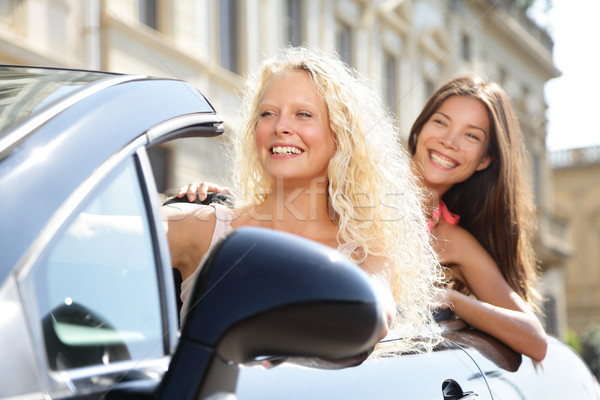 Car driver woman driving with girl friends Stock photo © Maridav