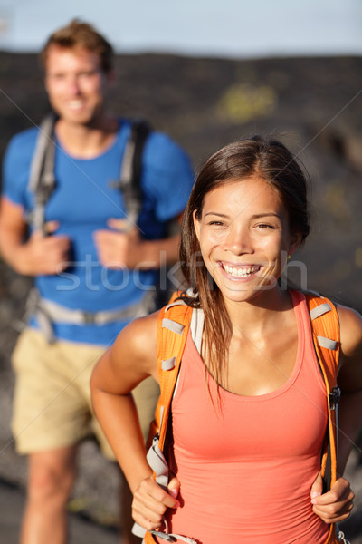 Hiking couple - Asian woman hiker walking on lava Stock photo © Maridav