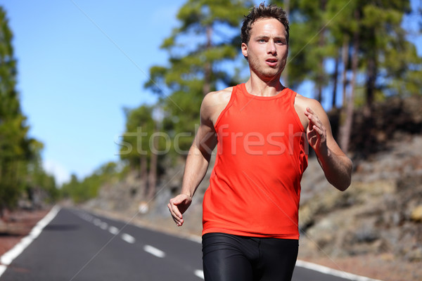 Sprinting runner man running fast Stock photo © Maridav