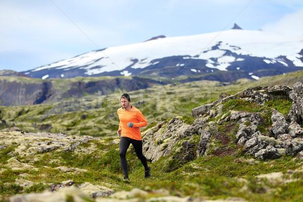 Running man athlete exercising trail runner Stock photo © Maridav
