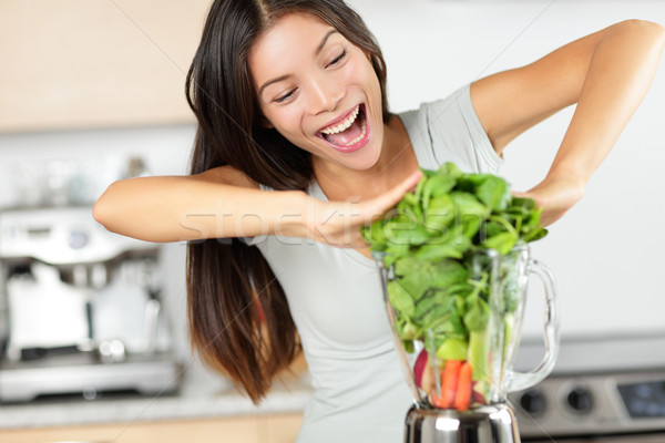 Stock photo: Vegetable smoothie woman making green smoothies