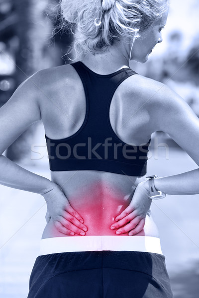 Back pain - Athletic running woman with injury Stock photo © Maridav