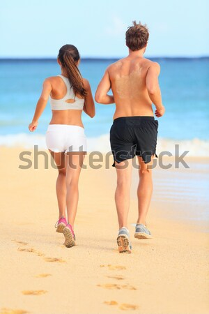 Stock photo: Couple romantic walking in beach sand holding hand
