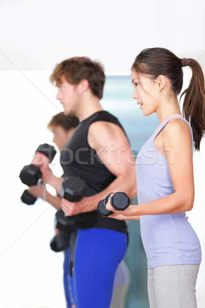 Fitness people in gym Stock photo © Maridav